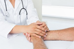 Provider holding patient hands