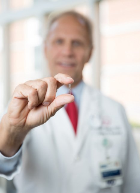 Dr. Stuckey holds a stent