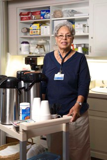 Volunteer serving coffee