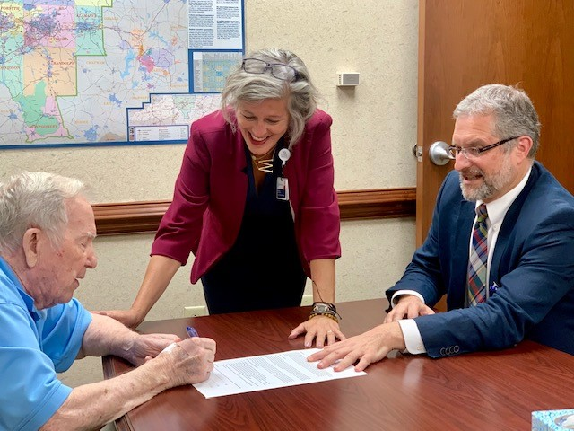Dr. Herring signing documents creating fund