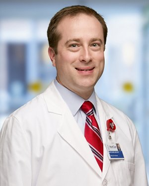 Mark C. Skains, MD